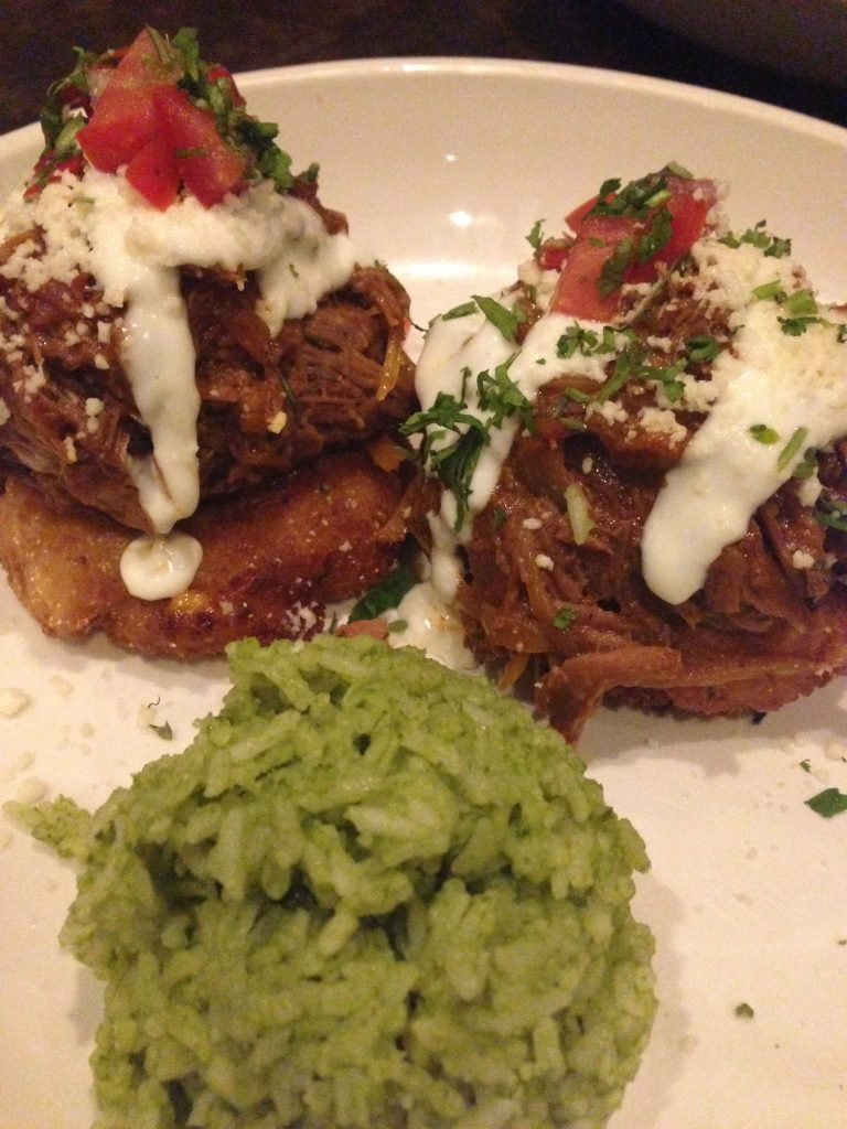 Delicia's Tamal Corn Cakes topped with Barbacoa Beef